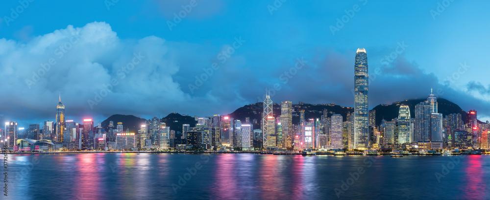 Fototapeta Panorama of Victoria harbor of Hong Kong city at dusk