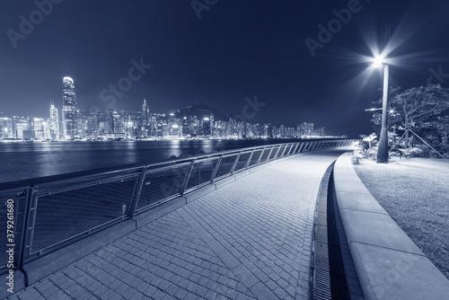 Seaside promenade and skyline of Hong Kong city at night Canvas Print
