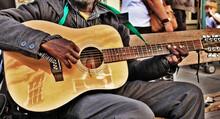 Street Musician Playing Guitar