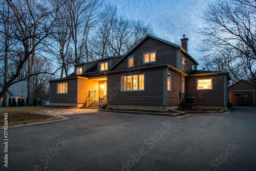 Real estate photography - exterior of single family house during twilight hours in Montreal's suburb