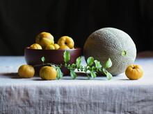Melon And Yellow Quinces On A ...
