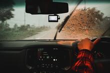 Man Driving A Car In The Rain ...