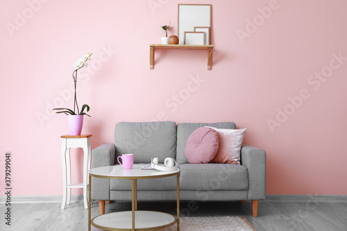 Fototapeta Interior of modern room with sofa and table obraz