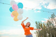 canvas print picture Young woman with balloons outdoors