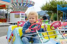 Portrait Of Little Boy In A Merry-go-round