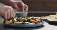 Man Making Salad With Nectarin...