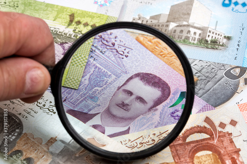 Syrian money in a magnifying glass a business background Fototapet