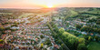 Aerial view of British town set in beautiful countryside in warm light of sunset