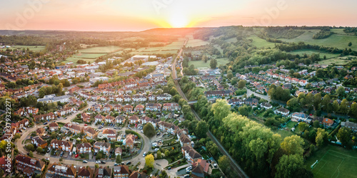 Aerial view of British town set in beautiful countryside in warm light of sunset Canvas-taulu