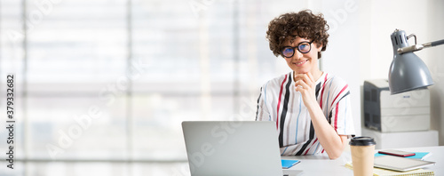 Fototapeta Portrait of business woman looking at camera at workplace in an office obraz
