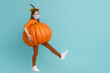 canvas print picture girl in pumpkin costume  wearing face mask