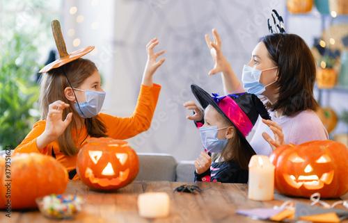 family celebrating Halloween Canvas Print