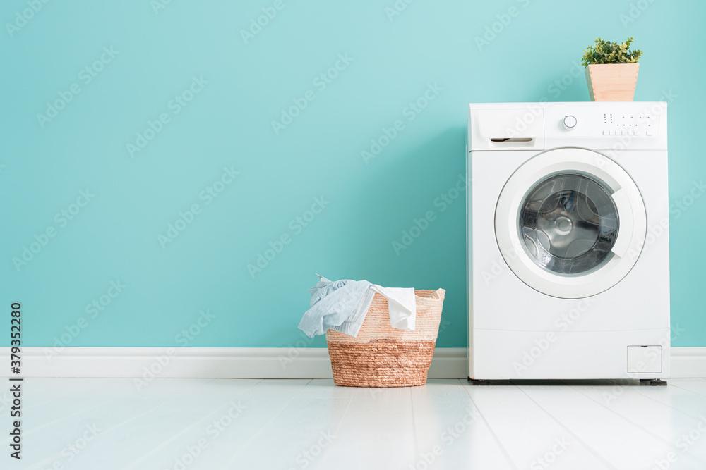 Fototapeta washing machine on teal wall background