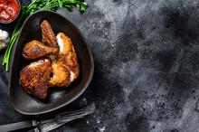 Half A Grilled Chicken On A Pl...