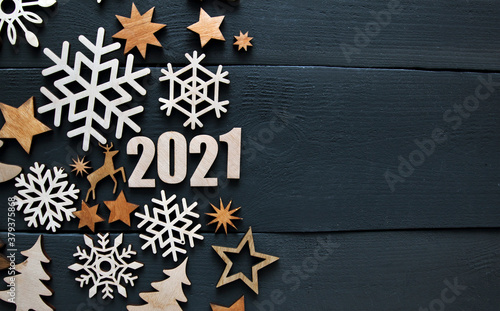 Valokuva The beautiful christmas background with a lot of small wooden decorations and wooden numbers 2021 on the wooden desk