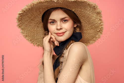 Romantic girl with pigtails and in a straw hat smile romance pink background Cop Canvas Print
