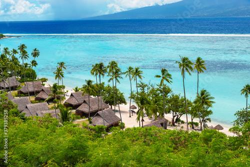 Fototapeta Luxury travel vacation with beach villas on Moorea Island, French Polynesia