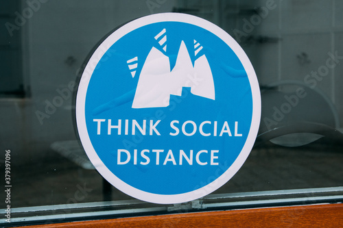 Closeup shot of a blue sticker about social distance in Euston railway station, Wallpaper Mural