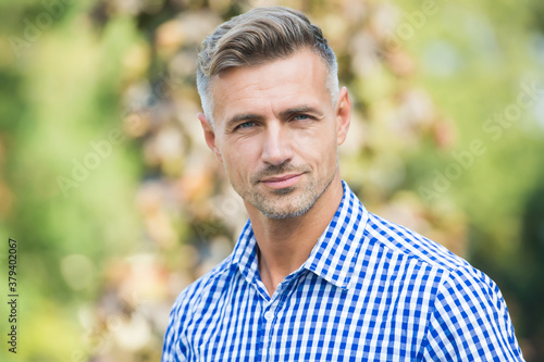 Fototapeta handsome mature guy in shirt outdoor, fashion obraz