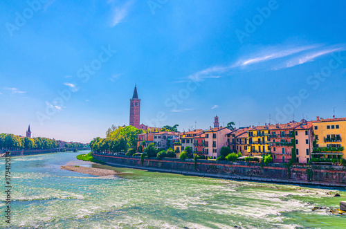 Verona cityscape with buildings on embankment of Adige river, bell tower Campani Canvas Print