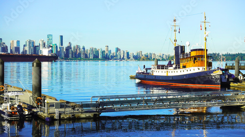 Photo Tugboat at Lonsdale Quay, North Vancouver, BC, with downtown Vancouver waterfron