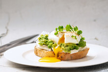 Avocado Egg Benedict With Crea...