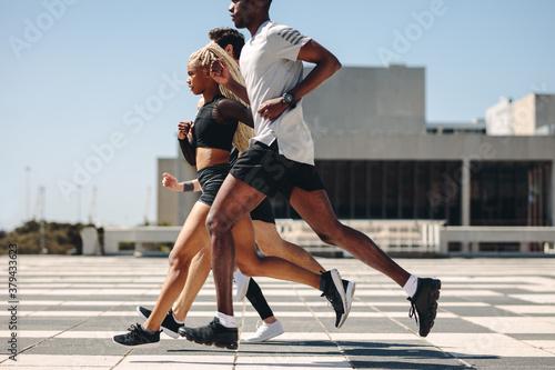 Fototapeta Street runner exercising in the city obraz