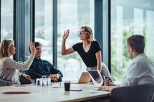 Corporate Professionals Celebrating Success In Meeting