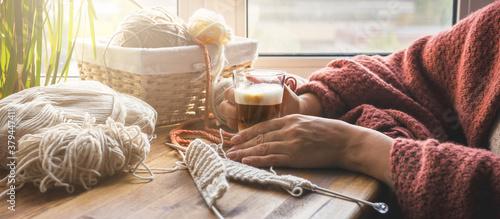 Fototapeta Knitting from threads at home. Hobby, relaxation, meditation, mental health during the quarantine period of the coronavirus lockdown. Stay at home, handmade, hobby, digital detox, zero waste,upcycling obraz