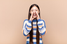 Asian Young Woman Feeling Happy, Excited And Positive, Giving A Big Shout Out With Hands Next To Mouth, Calling Out