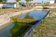 Agricultural Canal Or Irrigation Canal In A Concrete Wall Direct Water To The Farmer's Farmland In Arid Areas Of Risky Farming