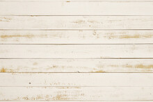 白く塗った荒い板、背...