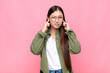 asian young woman looking angry, stressed and annoyed, covering both ears to a deafening noise, sound or loud music