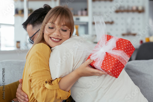 Fotografie, Obraz Husband surprising his wife with a gift
