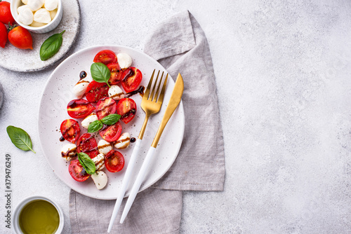 Obraz na płótnie Caprese salad with tomatoes and mozzarella