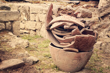 Large Broken Clay Pots Stand On The Ground .toned.