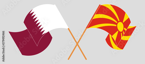 Crossed and waving flags of North Macedonia and Qatar Wallpaper Mural