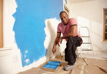 African American Man Painting ...
