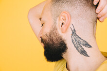 Close Up Of Man With Eyes Closed Showing Tattoo