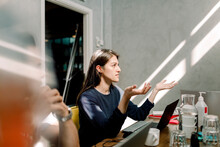 Businesswoman Gesturing While Sitting At Workplace