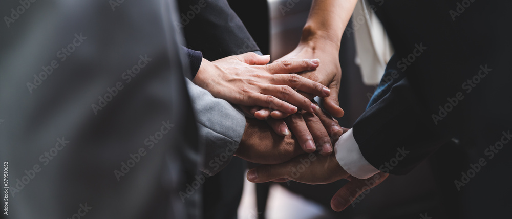 Fototapeta Large business team showing unity with their hands together, business success concept.