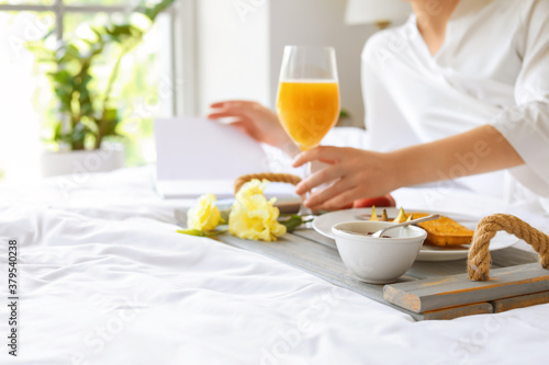 Young woman having tasty breakfast in bed Canvas Print