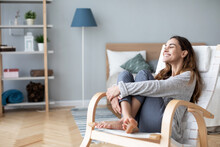 Woman Relaxing In Cozy Chair At Home. Female Portrait.