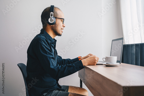 Young Asian businessman wearing shirt and casual shorts while online conference from home Canvas