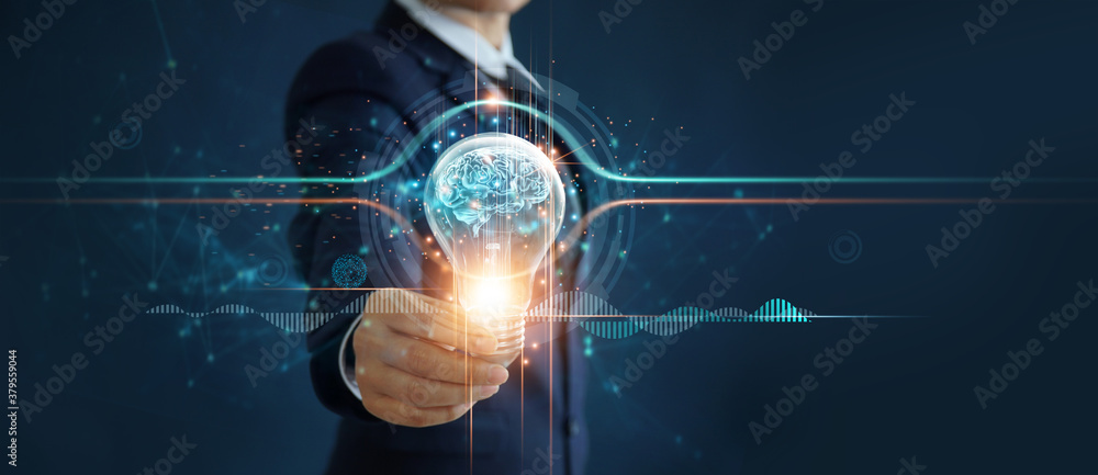 Fototapeta Businessman holding illuminated light bulb with brain inside, idea, creativity, innovation and inspiration of business on network connection background.
