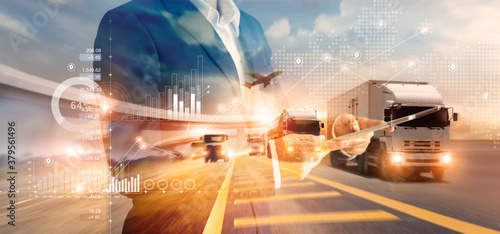 Double exposure of businessman and graph growth of business with world map of transportation and logistics network distribution and trucks of industrial cargo freight for shipping. import-export. - fototapety na wymiar