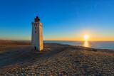 Denmark's most famous lighthouse Rubjerg Knude Fyr at sunset
