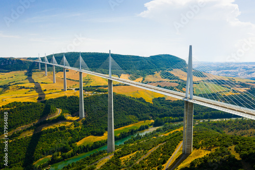 Fotomural Drone view of cable-stayed Millau Viaduct, highest road bridge in Europe, spanning Tarn River valley, Aveyron, France