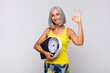 middle age woman feeling happy, relaxed and satisfied, showing approval with okay gesture, smiling. fitness concept