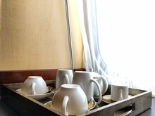 Elegant Fine Bone China Tea Or Coffee Cups Tableware Inside Suite Category Cabin Or Stateroom On Famous Cunard Ocean Liner Or Cruiseship Or Cruise Ship QM2 Queen Mary 2 In Front Of Porthole Window